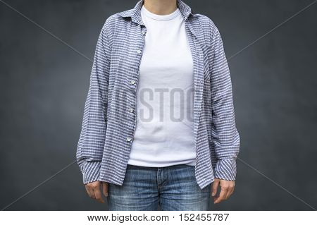 A casual girl wearing jeans and a plaid shirt with clean white T-shirt as copy space for graphic design print mock up.