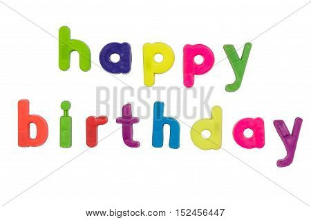 Plastic multicoloured plastic letters with the words Happy Birthday