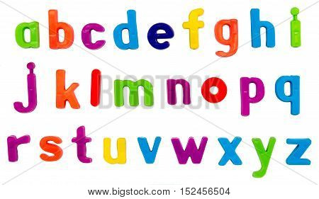 Plastic multicoloured plastic letters on a white background.