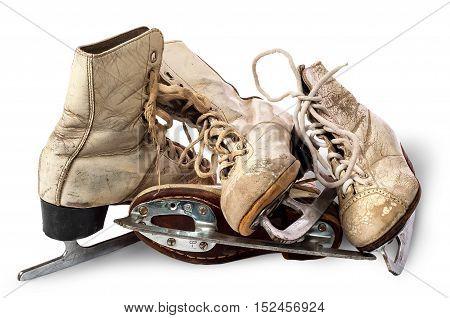 Pile of old female skates isolated on white background