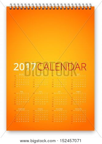 Simple calendar 2017 orange colored template. Week starts from sunday. Vector realistic spiral notepad notebook