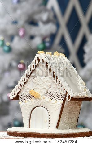 Gingerbread house, gingerbread Christmas tree, a snowman from sugar mastic - homemade sweets for children for Christmas