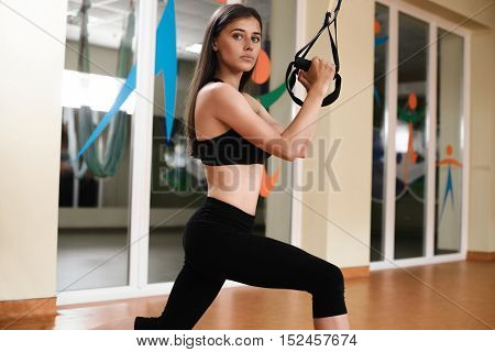 Young Woman Training Exercise Push Ups With Trx Fitness Straps In The Gym Concept Sport Workout Heal