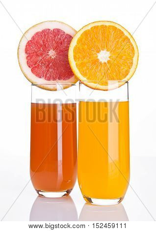 Glasses of healthy grapefruit and orange juice on white background