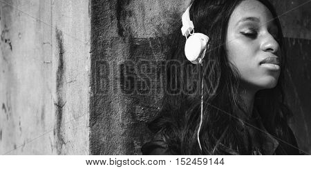 African Woman Listening Music Media Entertainment Relaxation Concept