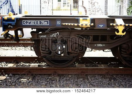 The side view of a disused railway car on a track.