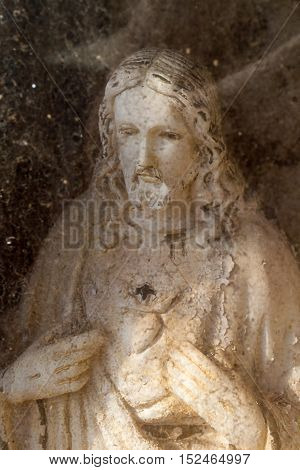 Vertical photo in color of Web in sacred hearth Jesus medium shot