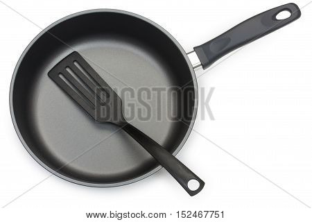 Black Frying Pan With Cooking Utensils: Plastic Paddle, Isolated On White Background, Close-up, Top