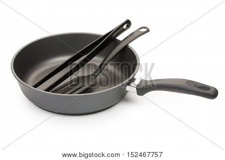 Black Frying Pan With Cooking Utensils , Isolated On White Background, Close-up.