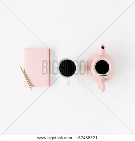 Feminine trendy home space: pink diary teapot coffee mug and golden pen. Flat lay top view