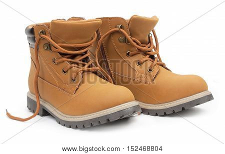 Yellow leather stylish children's shoes unlaced boots isolated on white background.