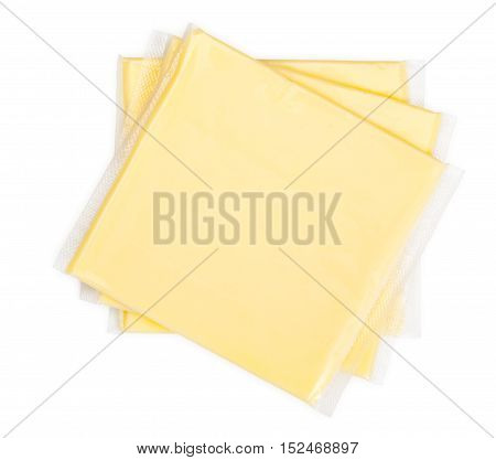 Three Yellow Cheese Slices Packaged On White Background. Close-up, Top View.