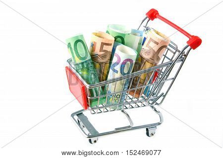 Euro banknotes rolled in supermarket Cart  with white background.