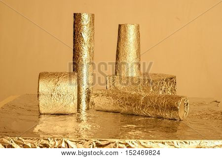 Gold foil figures with shiny crumpled surface. Contemporary art