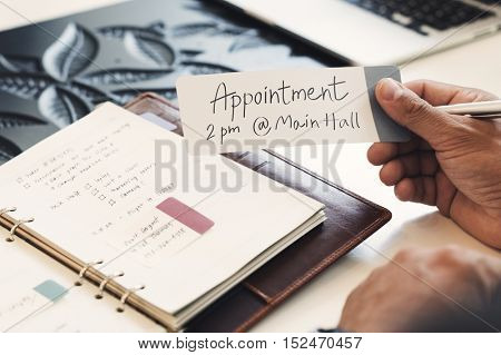 Business Man Holding Appointment Note Concept