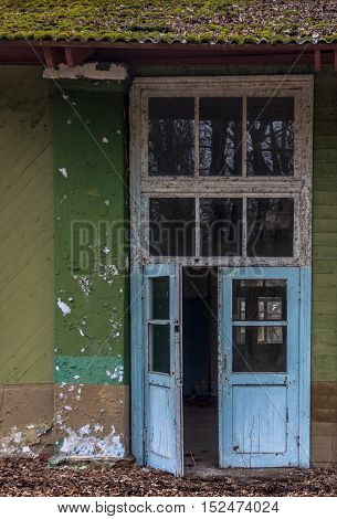 Wooden door in an old abandoned house