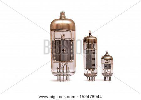 Group of old vacuum tubes isolated on the white background, radio valves.