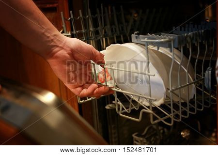 kitchen appliances clean dishes from the dishwasher gets