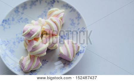 marshmallow on a plate with copy space tenderness concept