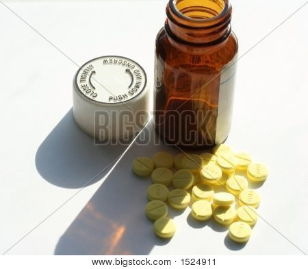 Pills And Upright Bottle