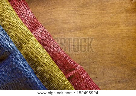 Flag of Chad government on a wooden background.