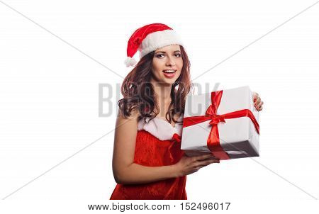 Young attractive girl in a suit of Santa Claus holds a Christmas gift. She is happy. Sale. Christmas mood.