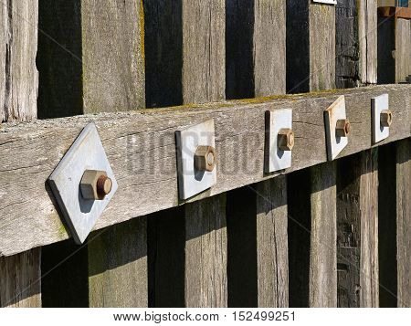 Wooden dock breakwall in a marina harbour as safety and protection method