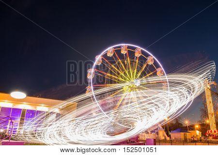 Amusement Park in the beautiful night lights of the amusement and illumination