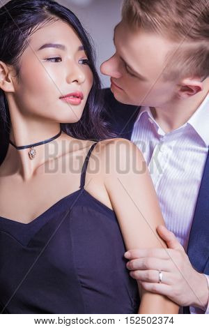 Close-up of romantic couple looking at each other in house