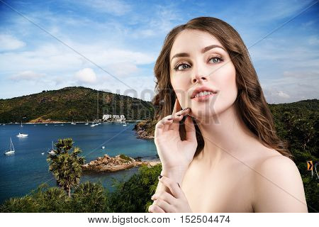Young beautiful sensual woman over natural background