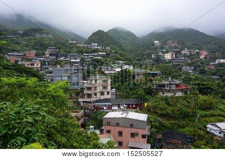 Houses in a small hillside village in the misty mountains of Jiufen, Taiwan