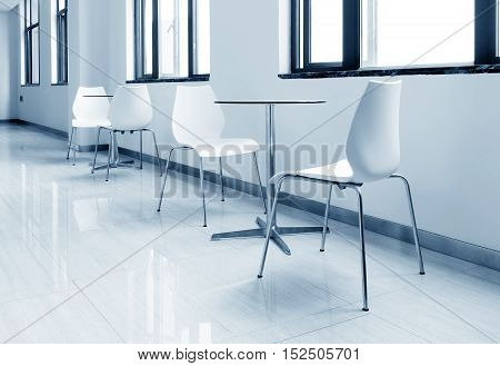 Round glass table and chairs in the hallway