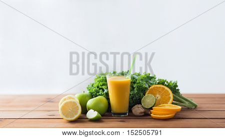 healthy eating, food, dieting and vegetarian concept - glass with orange juice, fruits and vegetables on wooden table