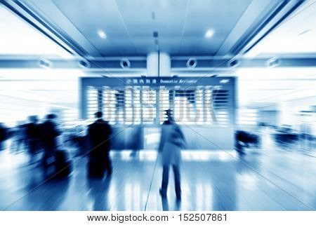 Passengers in Shanghai Pudong Airport; Motion Blur.