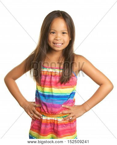 Cute Filipino Girl on a white background with her hands on her hips and a big smile.