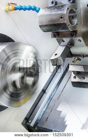 Rotary lathe chuck CNC metal cutting machine tool and tool holder.