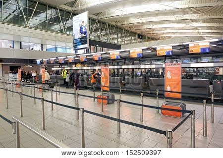 AMSTERDAM, NETHERLANDS - CIRCA NOVEMBER, 2015: check-in counters at Schiphol Airport. Amsterdam Airport Schiphol is the main international airport of the Netherlands.