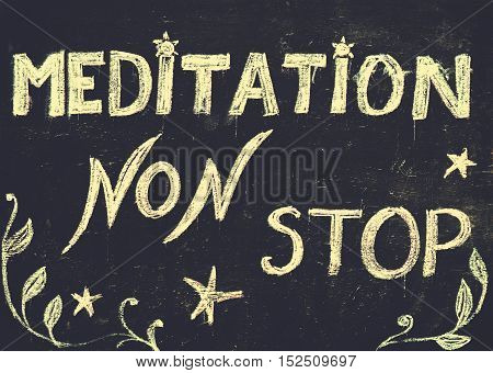 Meditation non stop sign, message written with chalk on blackboard. Healthy mind, body and spirit concept.