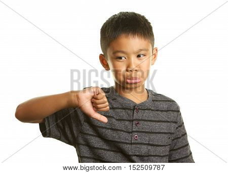 Cute Filipino Boy on a White Background with his thumb down looking unhappy