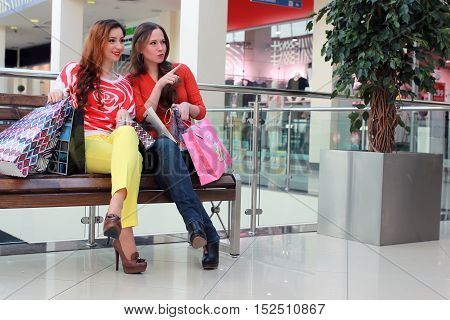 European lovely girl is engaged in a large shopping mall