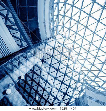 Transparent glass ceiling dome interior of modern building.