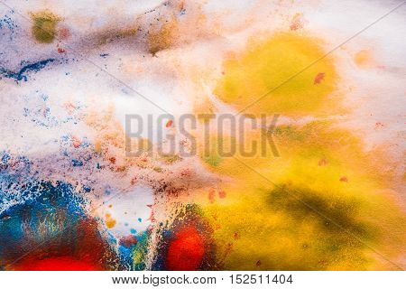 abstract background basis dried streaks of multicolored paint with cracks