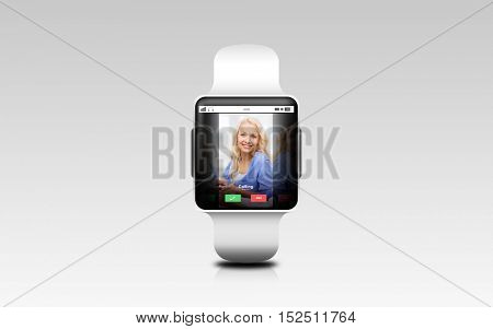 modern technology, communication, object and media concept - close up of black smart watch with incoming call on screen over gray background