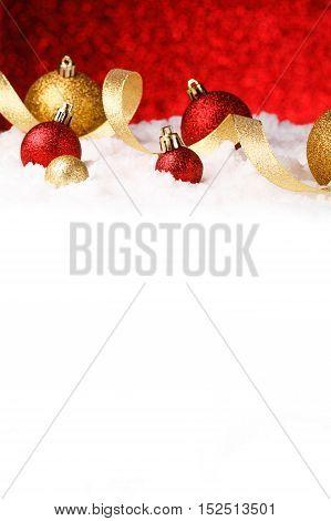 christmas ornament in snow on glitter background. studio shot