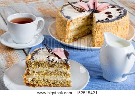 Sponge Cake With Poppy Seeds With A Cut Out Piece