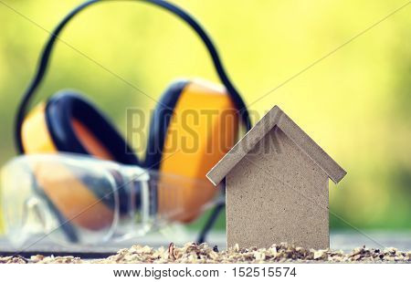 small wooden toy house and building inventory concept construction work