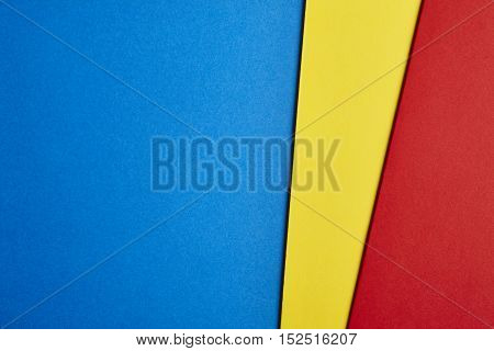 Colored cardboards background in blue yellow red tone. Copy space. Horizontal