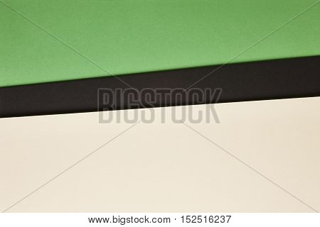 Colored carboards background in beige black green tone. Copy space. Horizontal