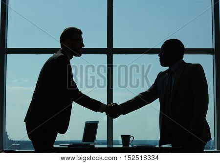 Greeting of businessmen
