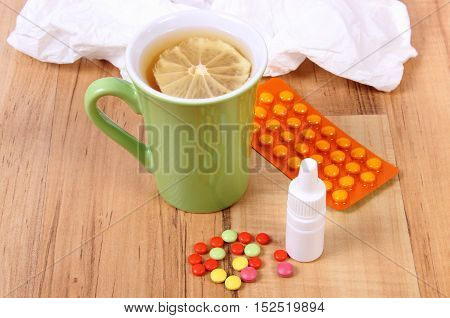 Pills And Nose Drops For Colds, Handkerchiefs And Hot Tea With Lemon